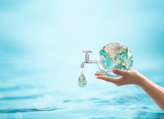 World water day, saving bio natural environment concept with hands holding green planet globe with drop water and blue ocean background. Element of the image furnished by NASA